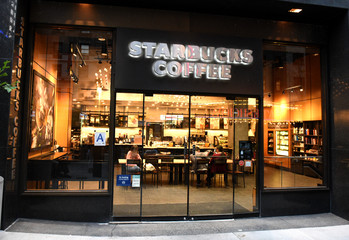 New York, USA - May 26, 2018: Starbucks Coffee in Midtown of Manhattan in New York.