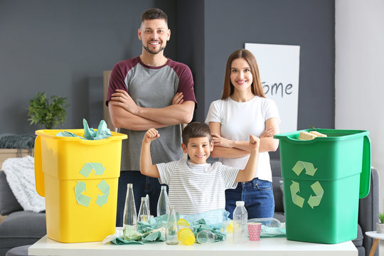 Family sorting garbage at home. Concept of recycling