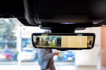 Rear view mirror in modern car with camera and display