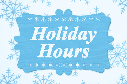 Holiday Hours message on a wood sign
