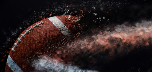 American football ball close up on black background.