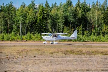 German-designed single-engine ultralight airplane B&F Technik FK-9 Mk.4, also marketed as the FK-Lightplanes FK9 Mk.4, OH-U509 landing on Karhula aviation museum airshow. Kotka, Finland.