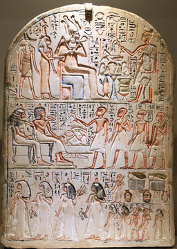 Funeral Stela. Egyptian priest offering food and drink to gods and death person.