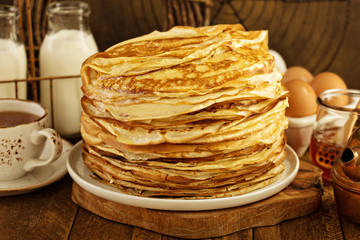 Stack of thin russian pancakes or crepes made for shrove Tuesday or Maslenitza, spring celebration