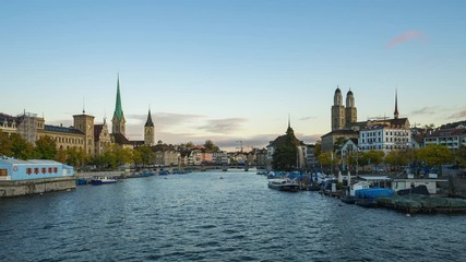 Wall Mural - View of historic Zurich city center with famous Fraumunster and Grossmunster Churches and Limmat river in Zurich, Switzerland time lapse