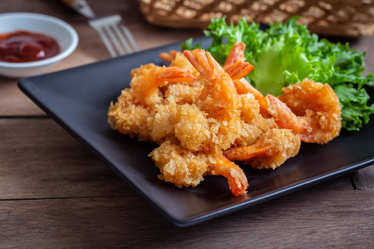 Fried shrimp and vegetable on plate.