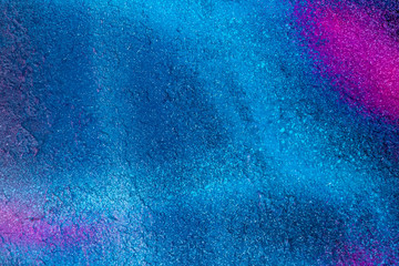 Beautiful bright colorful street art graffiti background. Abstract creative spray drawing fashion colors on the walls of the city. Urban Culture, black ,blue, purple , violet , neon texture