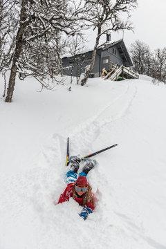 Fallen skier lying in powder snow
