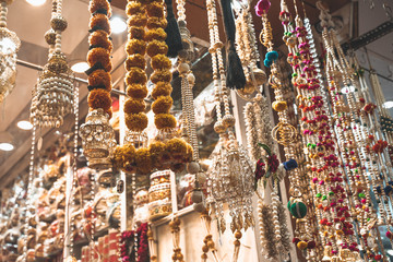 Deurstickers Historisch mon. Colorful metallic decorations on display for sale in Chandi Chowk Old Delhi. These flowers, beads and bells designs are popular in weddings, festivals and events.