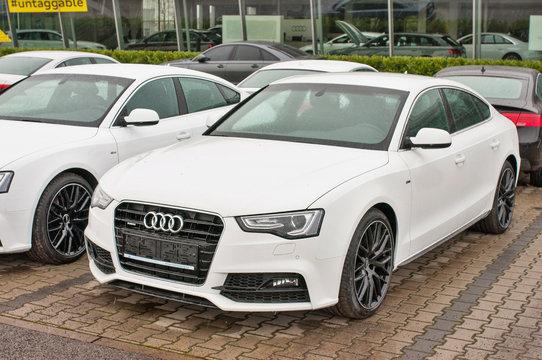 Closeup of new white car Audi A5 TDI quattro