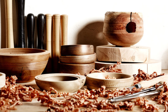 In the woodworkers shop. Woodturning project. Making handmade wooden bowls. Bowls workpieces  and tools.