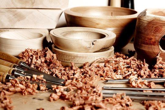 In the woodworkers shop. Woodturning project. Making handmade wooden bowls. Bowls workpieces on the workbench.