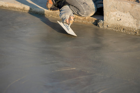 Plastering or pouring the floor with cement for construction