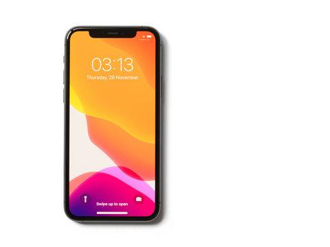 Riga, Latvia - November 28, 2019: Apple iPhone 11 Pro with locked screen on white background.