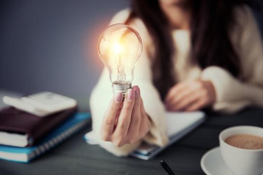 woman hand light bulb
