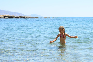 little girl having fun at summer vacation in sea