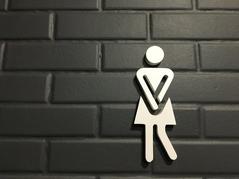 Women restroom pictograms. Funny toilet signing on black brick wall, desperate pee woman wc icons, fun bathroom door signs, humor public washroom urgent vector silhouette