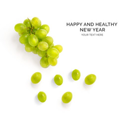 Creative happy and healthy new year card made of green grapes on the white background.  Green grapes happy new year, top view, festive greeting card.