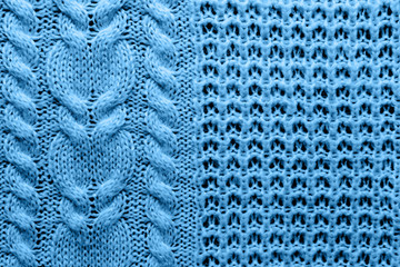 Abstract knitted background. Blue woolen sweater texture. Close up picture of  knitted pattern.