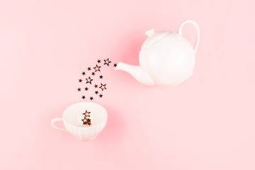 Papiers peints The Creative shot of star shape confetti pouring from tea pot.