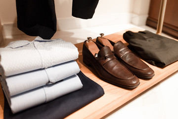 Stylish men's clothing and shoes in a clothing store