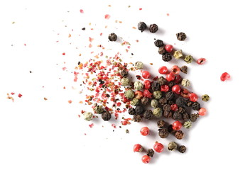 Colorful mixed pepper grains and flakes, isolated on white background, top view
