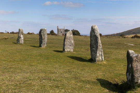 The Hurlers Stone Circle with abandoned Tin mine in the background near Minions in Cornwall on Bodmin Moor