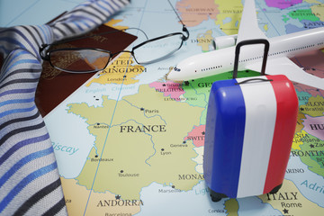 Vacation to France and tourism concept. Suitcase with french flag. 3D rendered illustration. Fotomurales