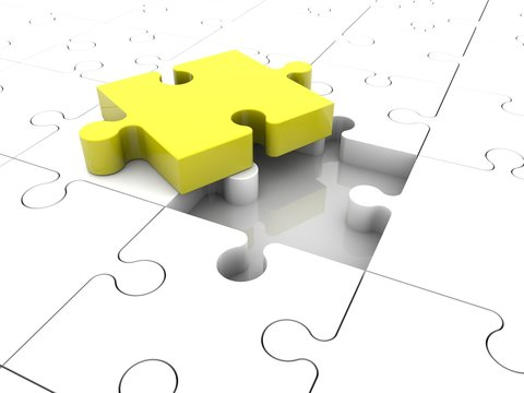 Yellow puzzle piece on white puzzle background
