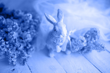 Easter composition with a hare in classic blue color