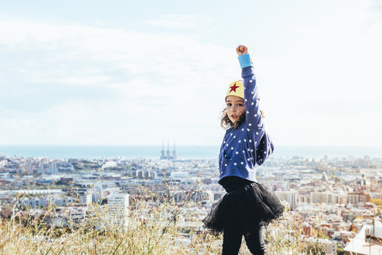 super girl posing powerful with fist in the air