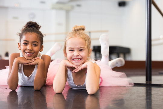 Two little girls rehearsing in dance school