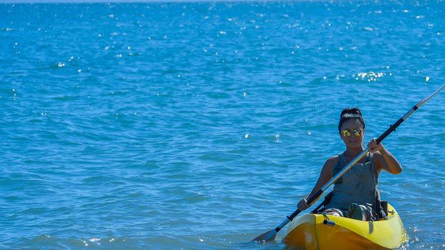 Asian woman kayaking Sea of Cortez.