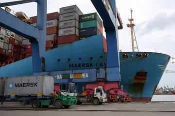A Maersk ship and containers are seen at the Port of Santos