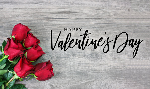 Happy Valentine's Day Calligraphy Logo Design with Beautiful Red Rose Flowers Over Rustic Wood Background