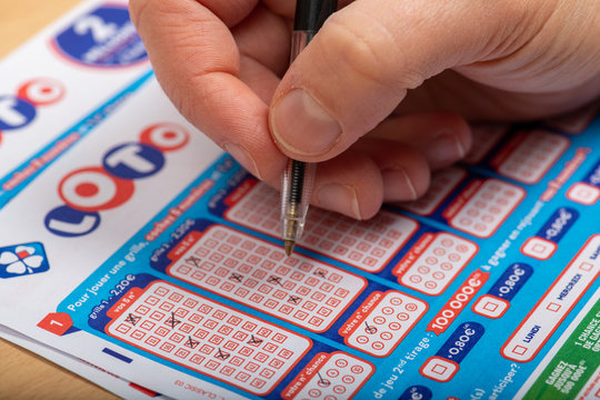 Paris, France -  November 21, 2019 : Closeup of aperson filling a lotto grid ,  from the society FDJ  (La francaise des jeux)