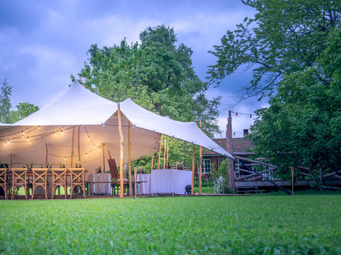 Image of huge white tent for a wedding event in the nature