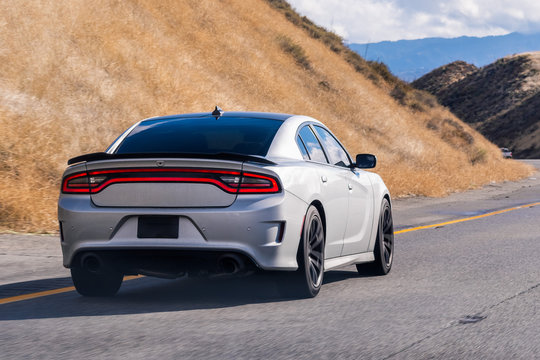 Dec 8, 2019 Los Angeles / CA / USA - Dodge Charger driving through the mountains en route to Los Angeles