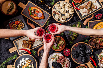 Georgian cuisine. A large laid table of different dishes for the whole family on a day off. Kebab, Lula, Lavash, Suluguni cheese, Khachipuri, Khinkali. background image, top view Wall mural
