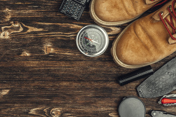 Hiking boots, compass and knife. Hiking outdoor equipment