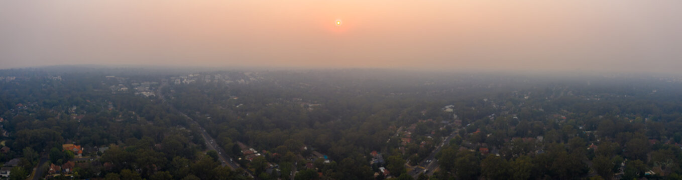 Heat wave. Bush fire smoke haze causes air quality issues and pollution over Sydney, reducing visibility and increasing risk of asthma and respiratory problems for people