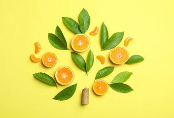Fototapete - Flat lay composition with fresh green citrus leaves and tangerine slices on yellow background