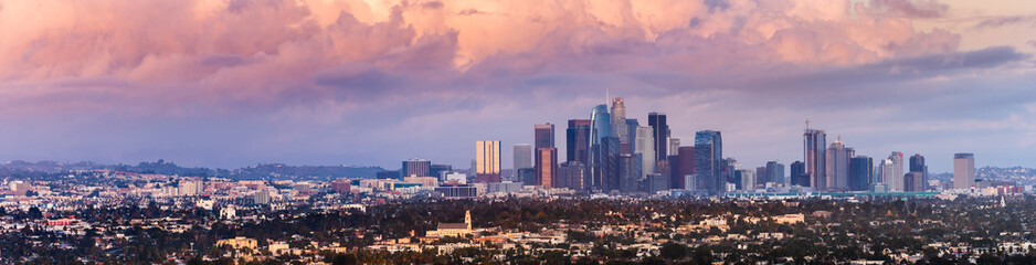 Panoramic view of downtown Los Angeles skyline at sunset, colorful storm covering the sky; California Wall mural