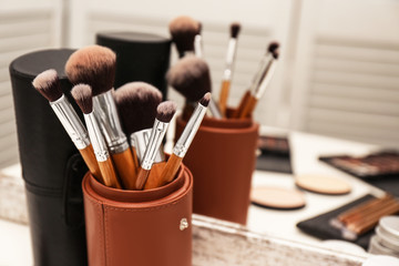 Professional makeup artists workplace with tools and cosmetic