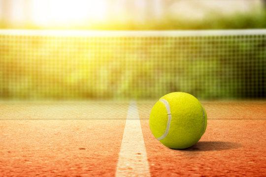 Closeup view of a tennis ball on the tennis court