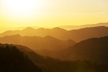 Foto auf Acrylglas Gelb Schwefelsäure Mountains silhouette