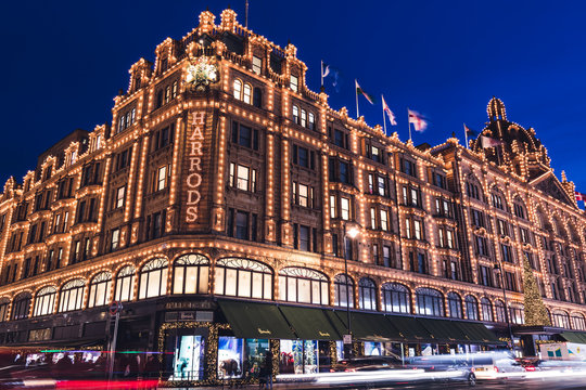 LONDON - DECEMBER 18, 2019: Harrods London department store shop at night with lights