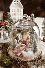 Christmas retro decoration with winter scene and Santa Claus inside glass dome