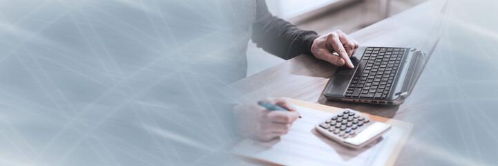 Obraz Accountant working on laptop; panoramic banner - fototapety do salonu
