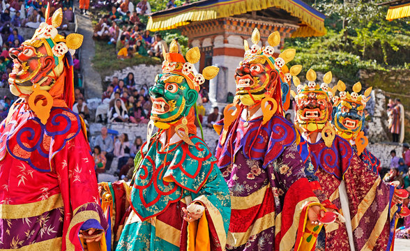 Performers dancers wearing masks in festival in Mongar, Bhutan